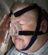 Sleep Apnea Sufferer with CPAP Mask
