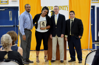 Ernest Robertson, Jr., director of athletics; Arasay Guerra;