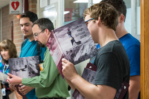 Harbor High School students line up to have their yearbook.'