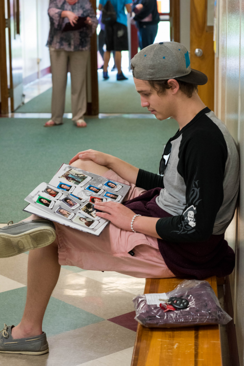 A Harbor High School student checks out his new yearbook.'