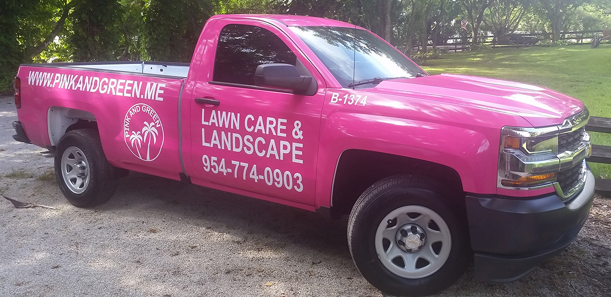 Pink and Green Lawn Care and Landscape's trucks.