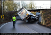 """A trucker got a 13'6"""" truck stuck under a 12&#'"""