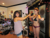 Theresa Torres spray tanning a model'