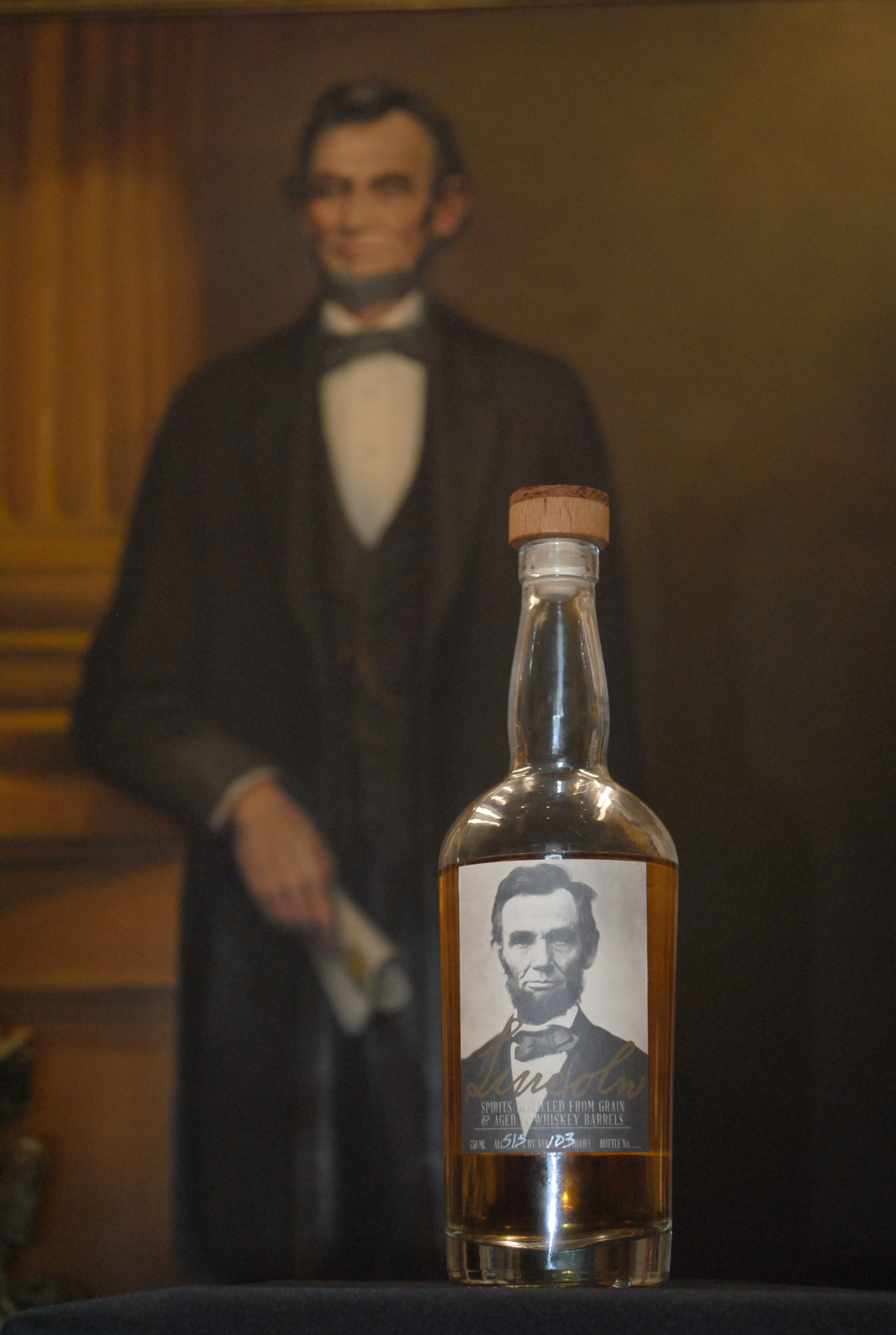 Lincoln bottle and portrait