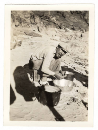 In this photograph, boatman Owen Clark cooks dinner for the