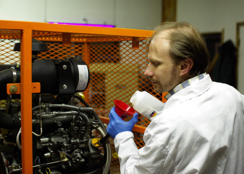 Dr. Rudenko setting up lubricant test in a fired diesel'