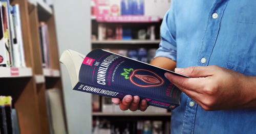 Man holding The Cunnilinguist book'
