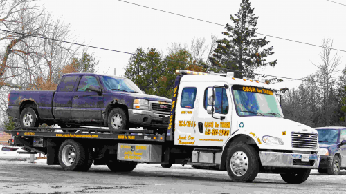 Truck getting towed away for recycling in Ottawa'
