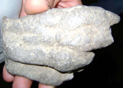 Basalt figure (Artifact 16).'