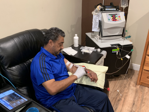 Raul Gutierrez prepares his at-home dialysis treatment'