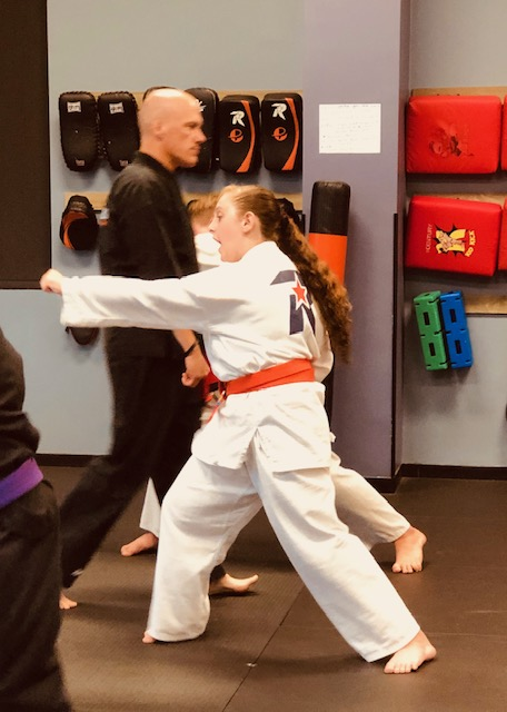 Teen Student practicing focus and punching.'