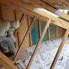Home attic insulation by First American Roofing'