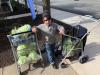 Cavanaugh Bell, 7, distributes carepacks.'