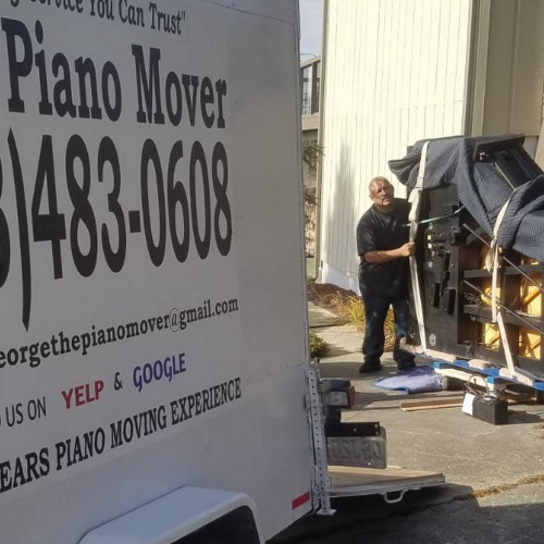 Company Logo For George The Piano Mover'
