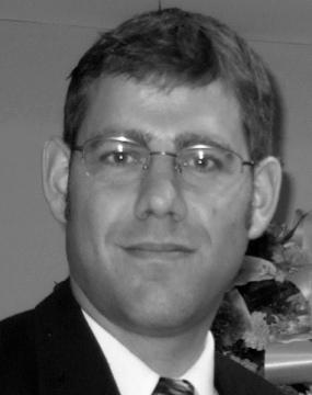 Dr Joel Lamoure, Director'