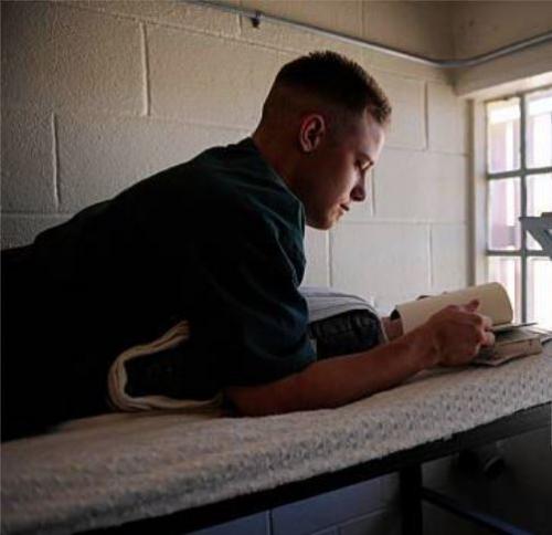 Inmate reading book 1'