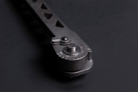 A closeup of the release button on the new Cole-Bar Hammer