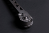 A closeup of the release button on the new Cole-Bar Hammer'