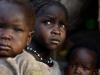 Girls wait for medical aid in Bram village in the Nuba Mount'