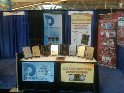 PatentPride.com INPEX 2013 booth patent plaques'