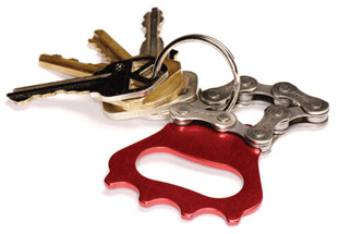 Used bicycle chain turned into bottle opener/key chain.