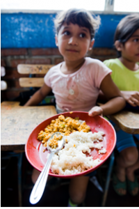 A young Nicaraguan girl shows the food she received.