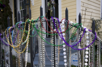 Mardi Gras beads on an iron gate in New Orleans. 2011.
