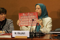 Maryam Rajavi Holding a Poster Of Ashraf Martyrs Photos