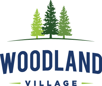 Company Logo For Woodland Village Apartments'