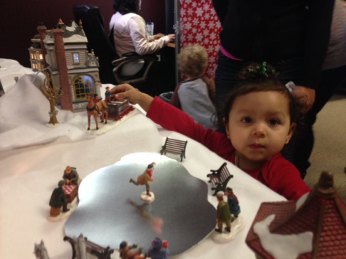 Children playing with Christmas village set'