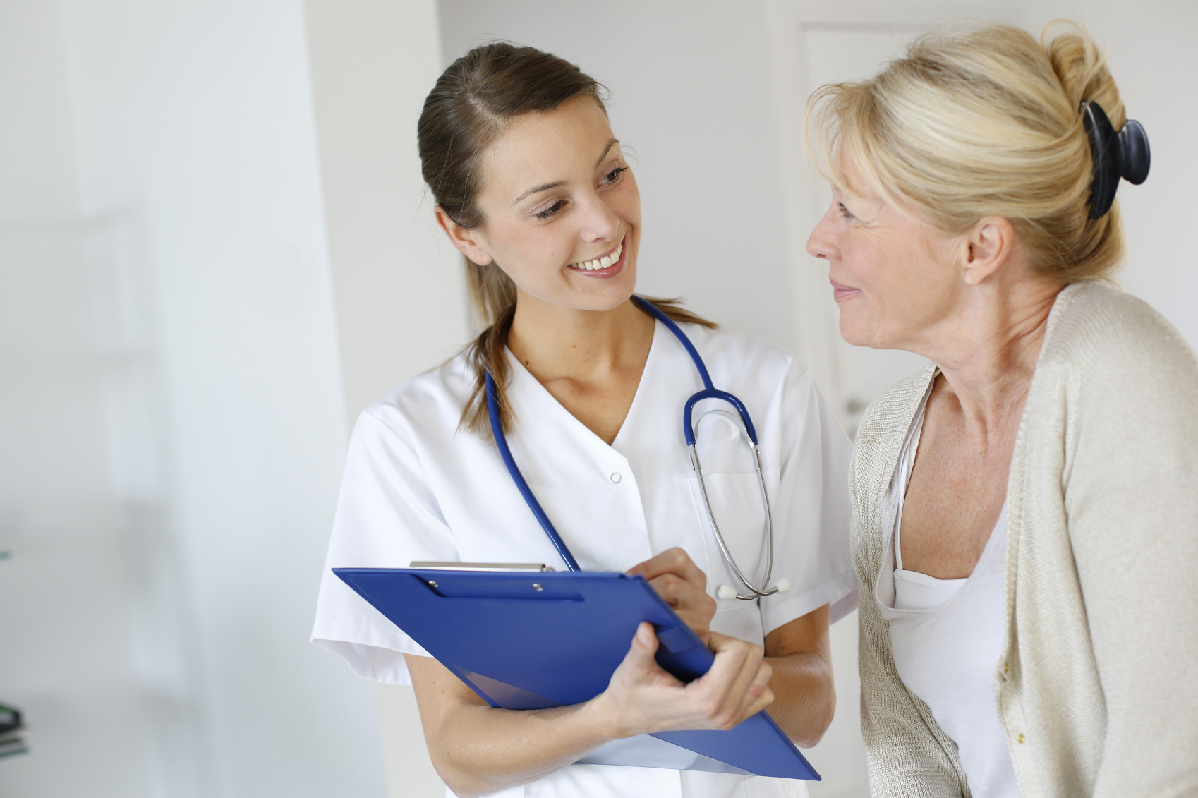 Woman Discussing Sexual Health Issues with Nurse
