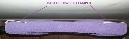 The Towel Hugger - Give Your Towel a Hug'