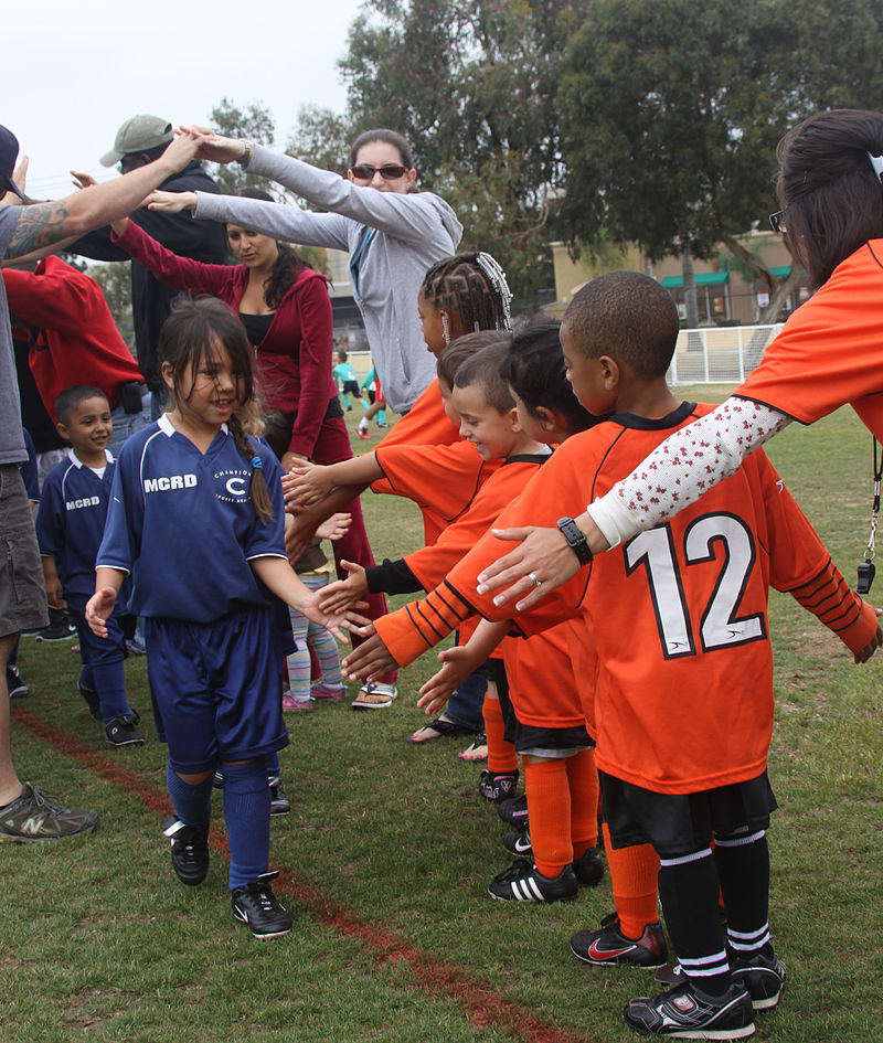 Young soccer players learn about sportsmanship
